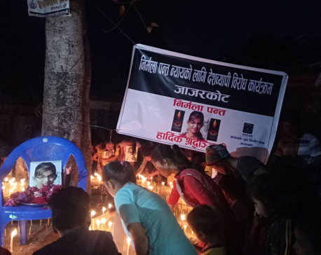 Candles lit demanding justice for Nirmala