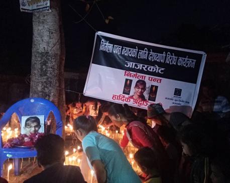 Candles lit demanding justice for Nirmala