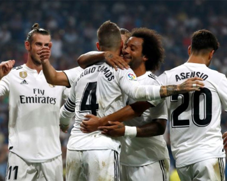 Real Madrid extend perfect start, Atletico lose at Celta