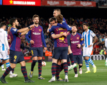 Barca put one hand on title after edging past Sociedad