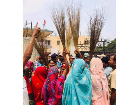 Brooms in hands, women protest against mayor