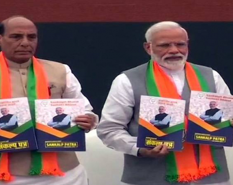 In run-up to Lok Sabha elections, India's ruling BJP unveils its election manifesto
