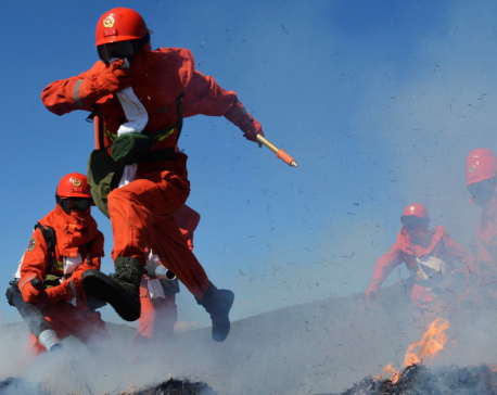 30 firefighters and volunteers die fighting forest fire in China