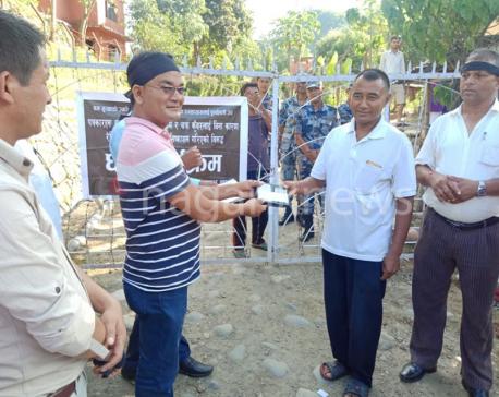 Agitating FNJ Doti chapter gifts broken radio set to Minister Baskota, MD Karki