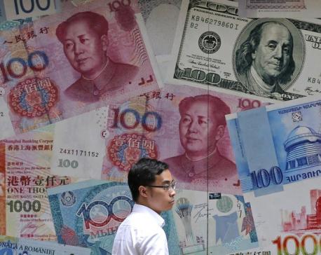 China's yuan falls below sensitive level of 7 to US dollar