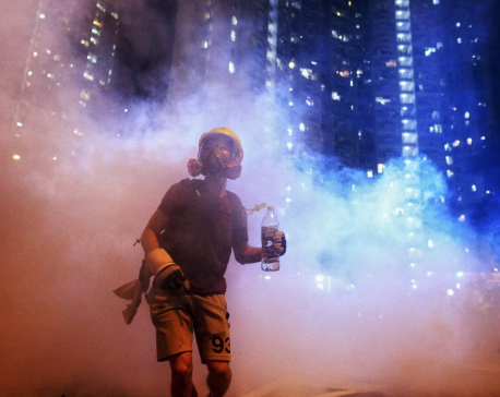 Hong Kong police arrest over 20 protesters in new scuffles