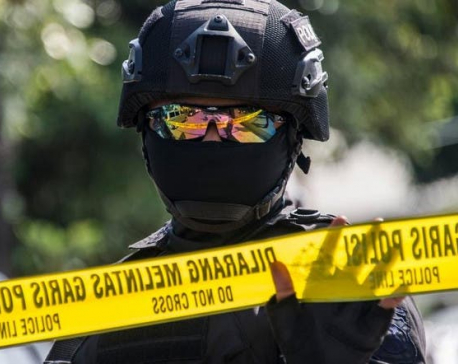 Indonesian police shoot suspected militant after officer slashed