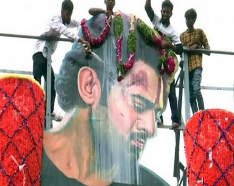 To celebrate 'Saaho' release, Prabhas fans pour milk on actor's cutout
