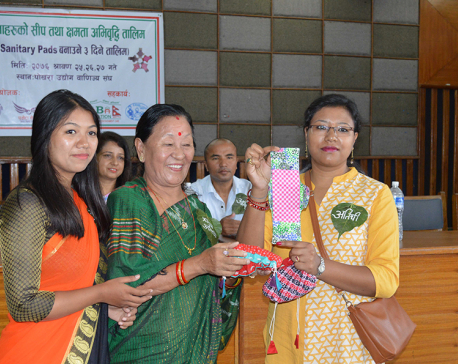 Women receive training to make sanitary pad