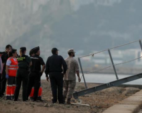 Over 150 migrants storm through Spain's enclave fence