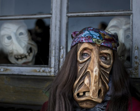 Costume-wearing Lithuanians chase winter away