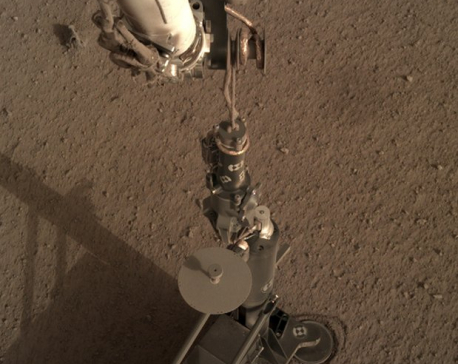 Mars lander starts digging on red planet, hits snags