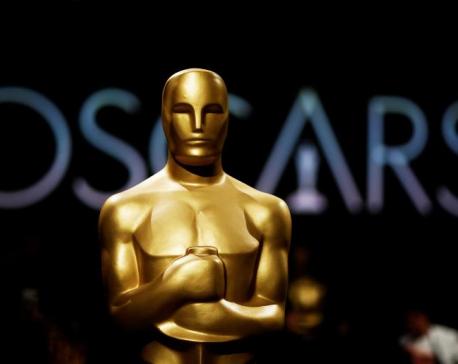 Oscar organizers scrap plan to award four Oscars in commercial breaks