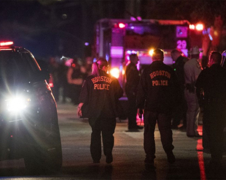 The Latest: 2 suspects dead, 5 officers hurt in shooting