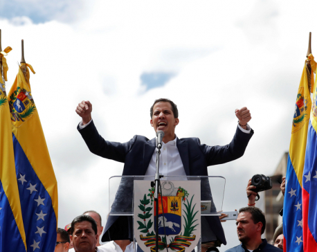 Maduro rival Guaido claims Venezuela presidency with U.S. backing