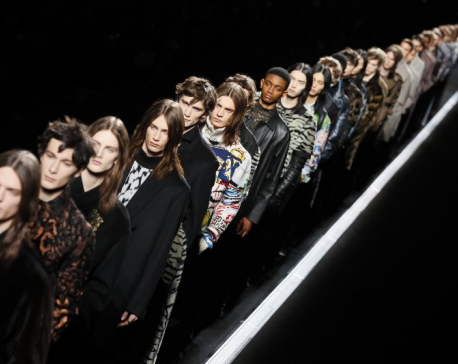 Dior pulls the stars in conveyor-belt menswear show in Paris
