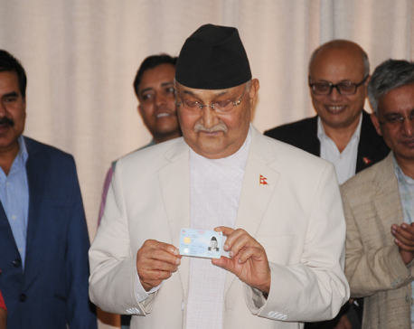 PM Oli receives national identity card