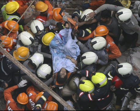 UPDATE: Rescuers find 14 bodies after building collapse in India