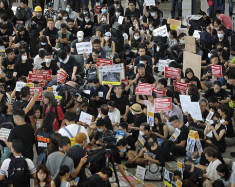Thousands defy police ban, march in Hong Kong district