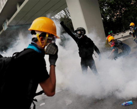 Tear gas fired, bricks thrown in Hong Kong clash over banned march