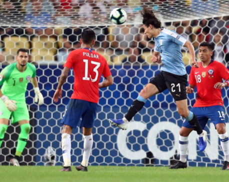 Cavani pounces against Chile to give Uruguay top spot