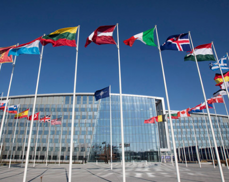 NATO defense ministers approve new space policy, discuss burden sharing