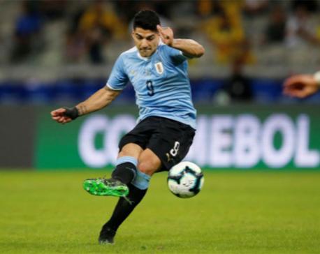 Uruguay crush 10-man Ecuador 4-0 in Group C opener