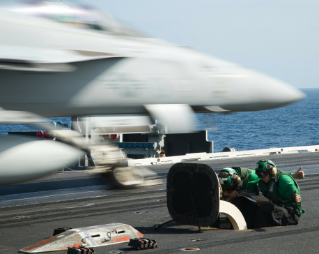US aircraft carrier deployed over Iran remains outside Gulf