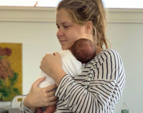 "Amy Schumer calls parenting ""nuts"""