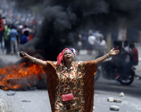 2 deaths as protesters burn tires, block roads in Haiti