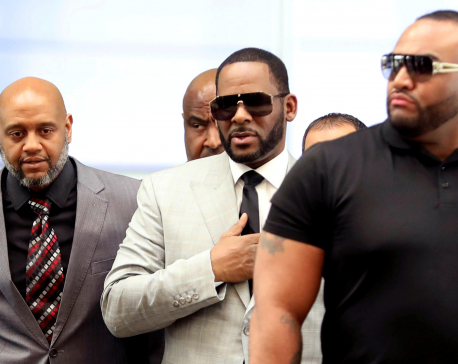 Singer R. Kelly charged in Minnesota with soliciting sex from minor