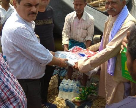 Indian Consulate in Birgunj distributes tarpaulins to storm-affected people in Bara