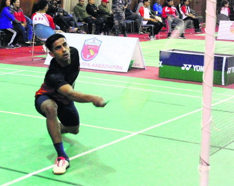 Dhami reaches badminton semis in three categories