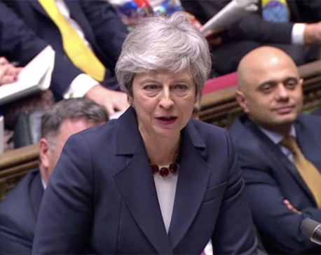 UK PM May defends Brexit delay, critic asks her to resign