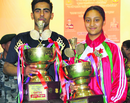 Dhami claims titles under three badminton categories