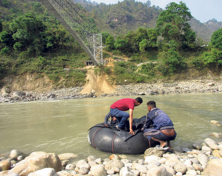 Locals still crossing Mahakali River using tubes as Indian officials defer inaugural of suspension bridge