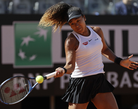 Osaka wins first of 2 matches in a busy day at Italian Open