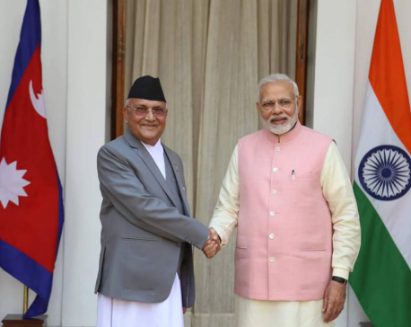Prime Minister Oli returns home from India