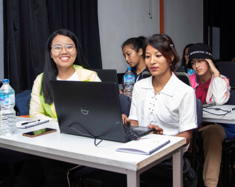 Red Circle Empowering Women as an Girls in ICT Day Initiative