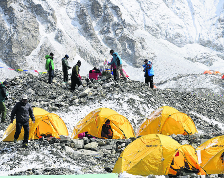 With ropes fixed on Everest, climbers head for summit