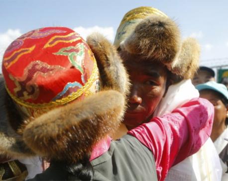 Nepal's record-setting Everest guide returns hero