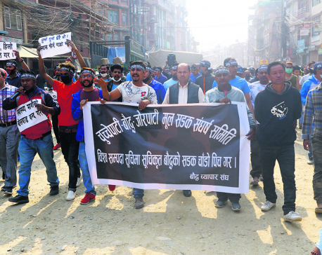Locals protest sluggish road work