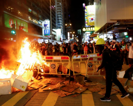 Hong Kong police break up new protest with rubber bullets, tear gas