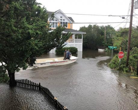 Dorian's floodwaters trap people in attics in North Carolina