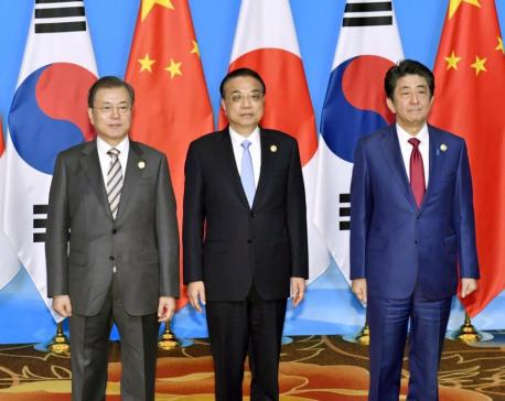 China, Japan, South Korea meet on North Korea, free trade