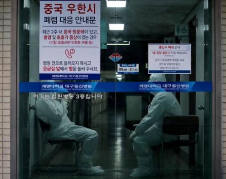 South Korea raises disease alert to top level as virus cases soar