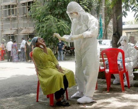 India's daily coronavirus cases at about 20,000 as some cities extend lockdowns