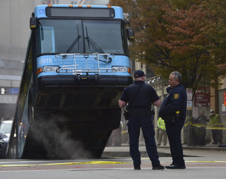 Cranes remove bus partially swallowed by Pittsburgh sinkhole