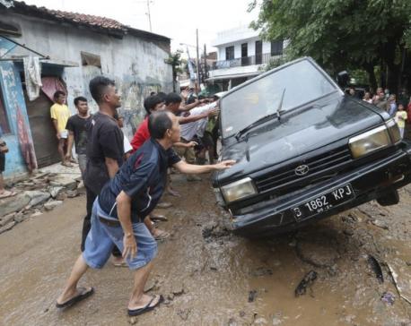 Indonesia plans cloud seeding to halt rain, floods death toll rises to 43