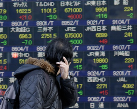 Asian markets mostly rise as dollar gains